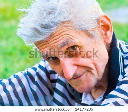 Senior man with wisdom smile on his face - stock photo