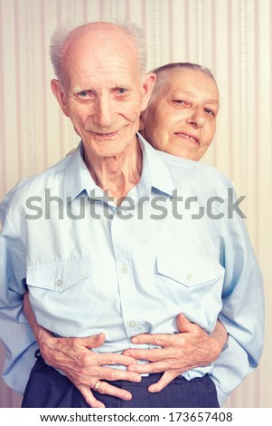 Senior Man, Woman with their at Home. - stock photo