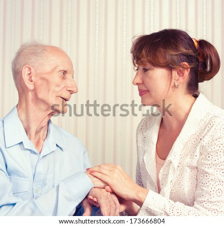 Senior Man, Woman with their Caregiver at Home. - stock photo