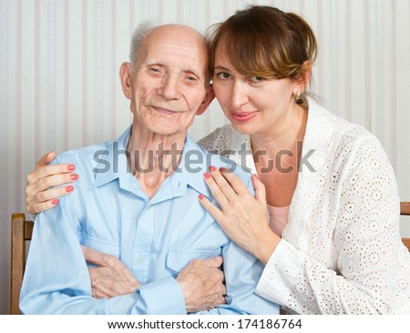 Senior Man, Woman with their Caregiver at Home. Concept of Health Care for Elderly Old People, Disabled - stock photo