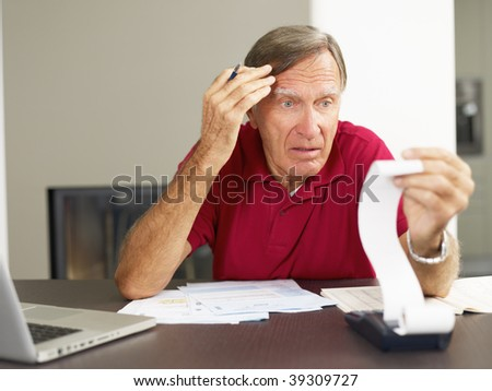 Senior man worried about his home finances. Copy space - stock photo