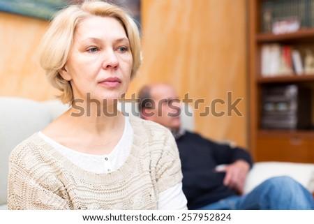 Senior married couple having quarrel at home - stock photo