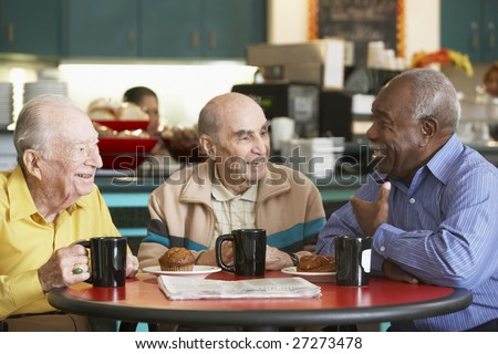 Senior men drinking tea together