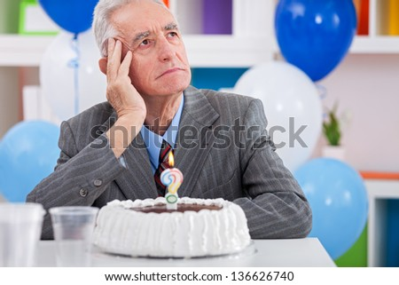 Senior men sitting front of cake birthday ask yourself how old am I - stock photo