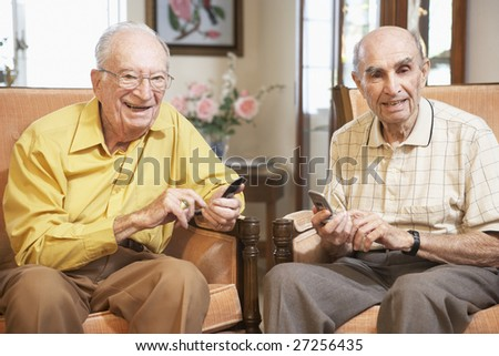 Senior men text messaging - stock photo