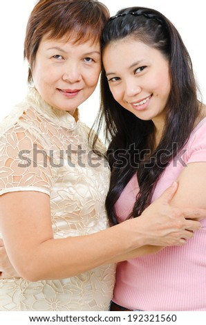 Senior mother and adult daughter holding hands bonding isolated on white background. Mixed race Asian family portrait.  - stock photo