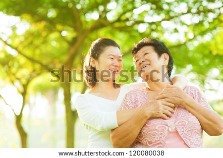 Senior mother and daughter having fun time at outdoor - stock photo