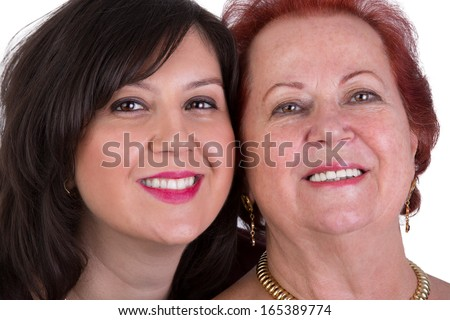 Senior mother and her middle age daughter cheek to cheek portrait - stock photo