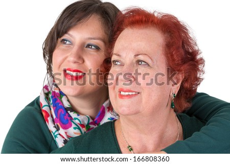 Senior mother and her middle age daughter close to each other portrait, perhaps its mother's day - stock photo