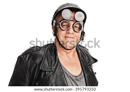 Senior motorcyclist with a black helmet and goggles looking at the camera isolated on white background