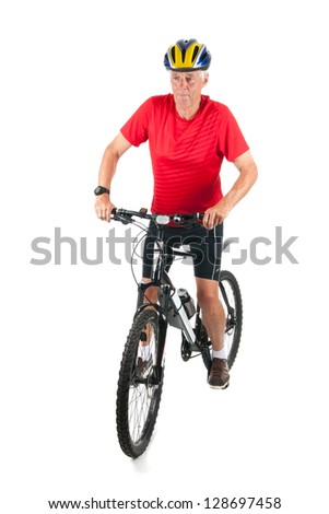 Senior mountainbiker in studio - stock photo