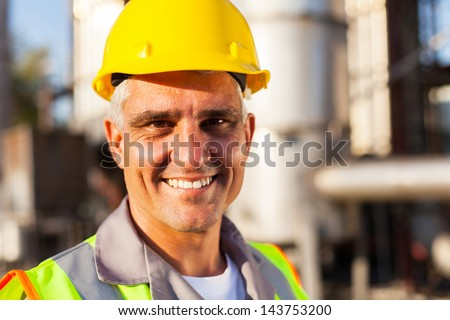 senior oil and chemical worker closeup portrait - stock photo