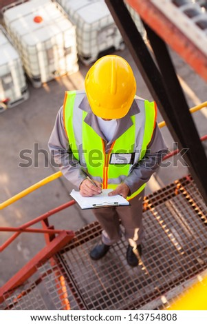 senior oil chemical worker working in refinery plant - stock photo