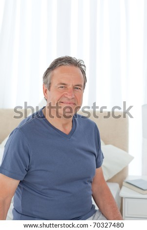 Senior on his bed at home - stock photo