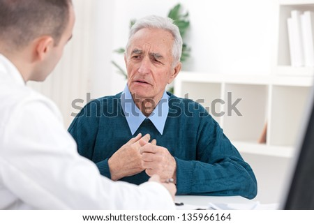 Senior patent complained doctor about his problem - stock photo