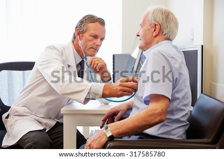 Senior Patient Having Medical Exam With Doctor In Office
