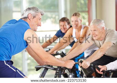 Senior people in class with trainer in a gym - stock photo