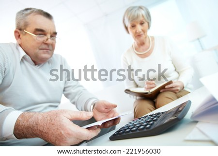 Senior people planning their home finances - stock photo
