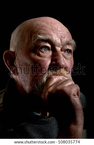 Senior person deep in thought - stock photo