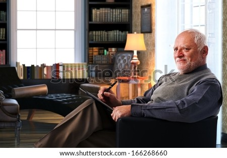 Senior psichoanalyst t work, writing notes, listening. - stock photo