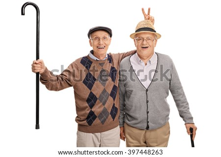 Senior pulling a bunny fingers prank on his friend isolated on white background