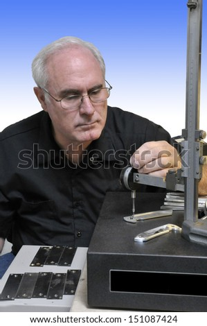 Senior Quality Inspector checking dimensions on a manufactured part