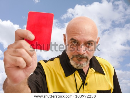 Senior referee image showing card at the view - stock photo