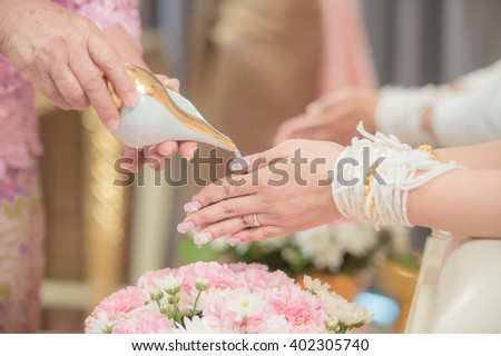 Senior Relatives Give Water Blessing To New Bride And Groom Thai Traditional Wedding Ceremony