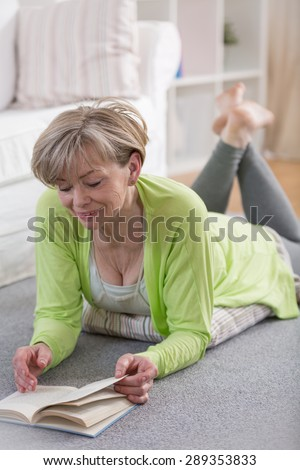 Senior retired woman reading the book in her free time