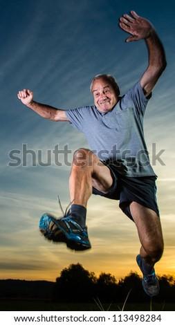 senior running in sunrise - stock photo