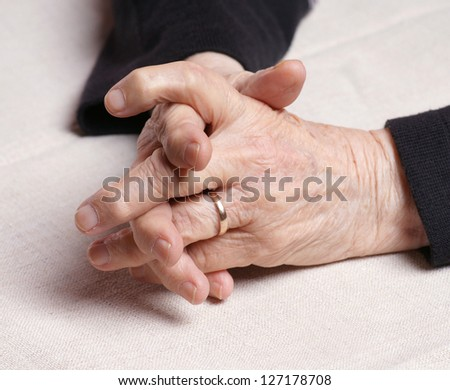 Senior's hands on a table