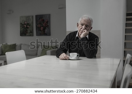 Senior sad lonely man and his coffee time - stock photo
