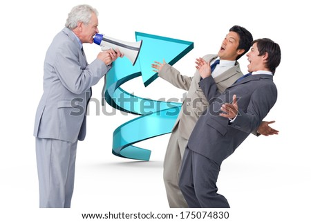 Senior salesman with megaphone yelling at his employees against blue spiral arrow - stock photo