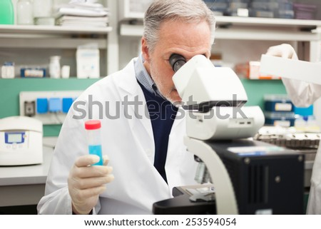 Senior scientist at work in a laboratory - stock photo