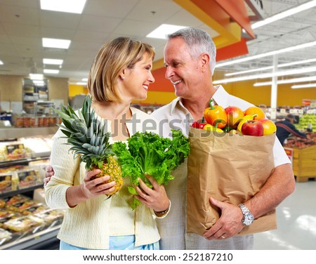 Senior shopping couple with grocery items . Healthy diet. - stock photo