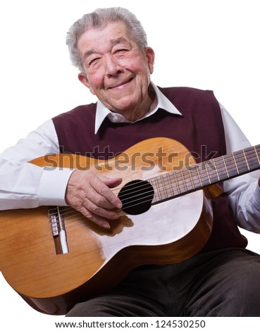 Senior spielt mit Freude Gitarre - stock photo
