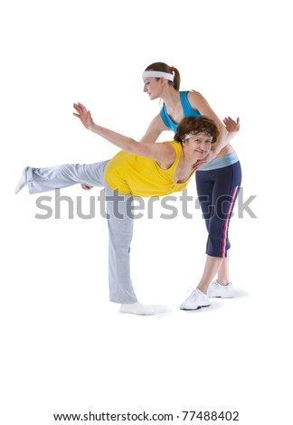 senior sportive woman stretching with instructor - stock photo