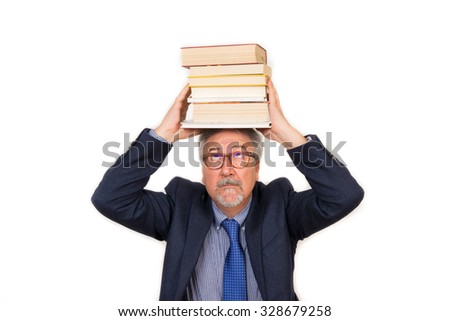 Senior student man lifting pile of old books above head - stock photo