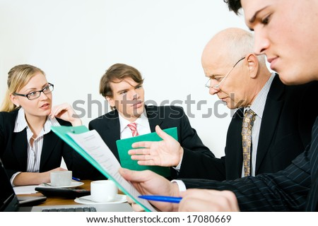 Senior Team leader making a decision. Period! (focus only on the senior man!) - stock photo