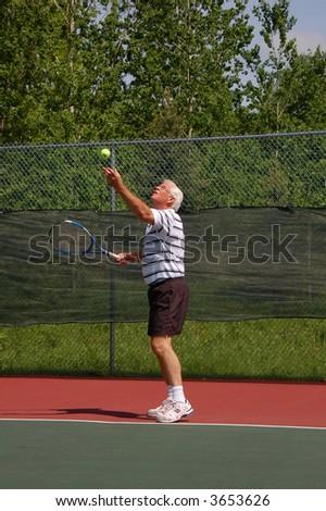 Senior Tennis Player, Ball Toss - stock photo