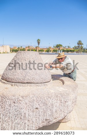 "Senior tourist and  historic quern, ""Place 20 Aout"" in Taroudant, Morocco"