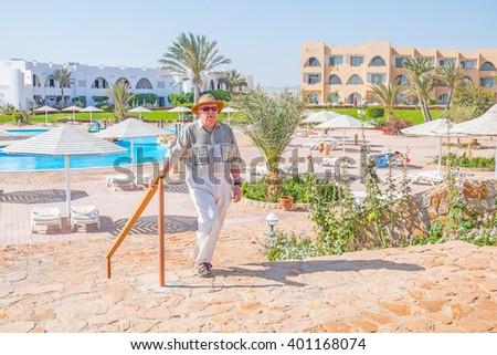 Senior tourist in a resort in Marsa Alam, Egypt  - stock photo
