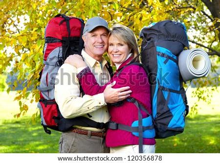 Senior tourists couple hiking at the park. - stock photo