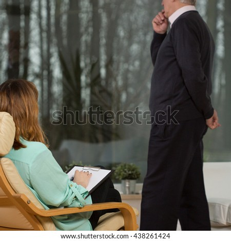 Senior troubled man and his young female psychotherapist