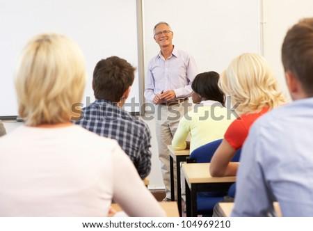 Senior tutor teaching class - stock photo
