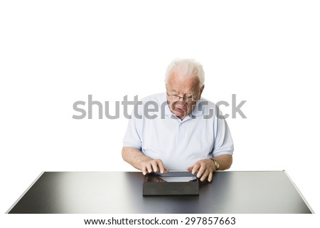 Senior using a tablet computer