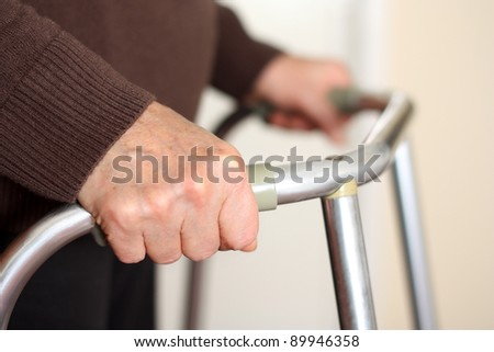 Senior using a walker - stock photo