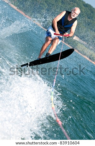 Senior wake jumping - stock photo