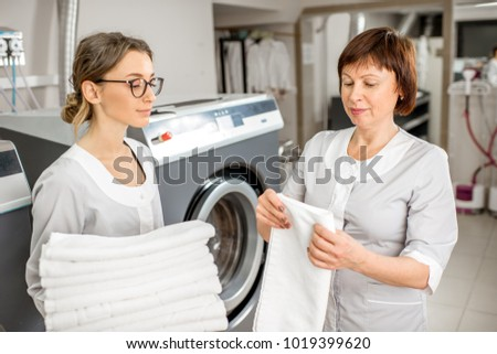 Senior Washwoman Making Clean Towels Young Stock Photo 1019399620 ...