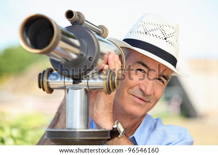 senior watching through a telescope